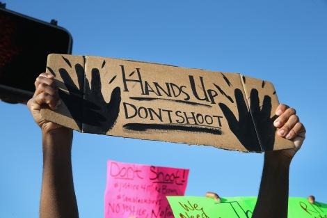 HANDS-UP-FERGUSON-GOVERNMENT-VIOLENCE