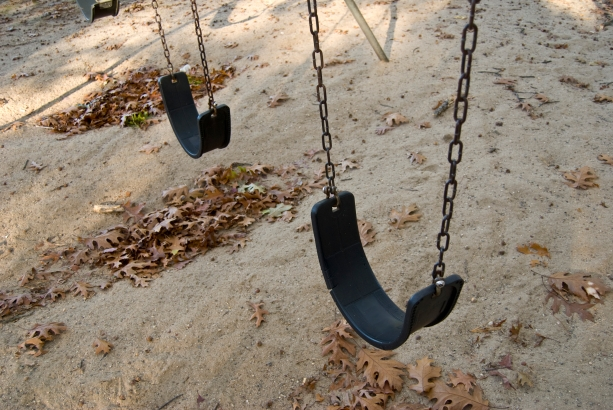 some-empty-playground-swings-at-the-park_HFuDjwRSs.jpg